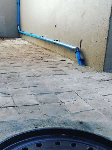 Storm water collection tank installation with drainage pump